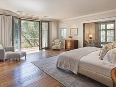 The master bedroom gets a lot of natural light, and even has a reading nook.