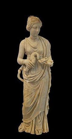 Hygieia, Roman statuette (marble), 2nd century CE, was the daughter of the god Asclepius, and Epione. She was the goddess of health, cleanliness and sanitation. Hygieia and her five sisters each performed a facet of Apollo's art: Hygieia (goddess of health, cleanliness, and sanitation), Panacea (goddess of universal remedy), Iaso (goddess of recuperation from illness), Aceso (goddess of the healing process), and Aglæa/Ægle (goddess of beauty, splendor, glory, magnificence, and adornment).
