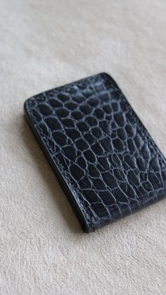 Money Clip style in Black Croc, with tonal Calfskin leather lining and Michael Louis New York debossed.   See more of this style --> https://michaellouis.com/collections/leather-money-clips/products/money-clip-black-croc  Money Clip   #MichaelLouis - www.MichaelLouis.com