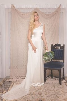 The Alana bridal gown by Cathleen Jia. Made from 100% silk, adorned with draped georgette and hand beading.