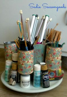 A thrift store lazy susan and tin cans for your recycling bin come together in this amazing project- a spinning organizer! A little craft paper and some glue really turn this into something you'll be proud to have on your desk! #sadieseasongoods