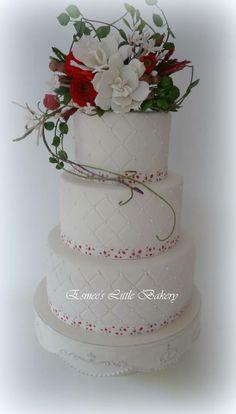 Gardenia and Ranunculus Wedding Cake. - *