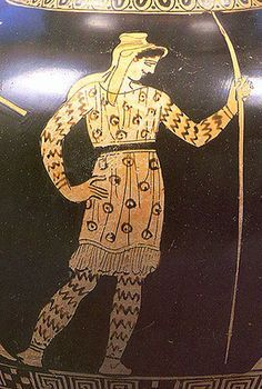 ancient Greek depiction of an Amazon warrior wearing patterned tunic and pants. discussion of the ancient origin of pants.