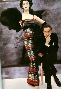 Designer Norman Norell and Dovima wearing the Roman striped version of his famous sequinned evening gown, 1956. Photo by William Helburn.