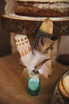 Feathers in a mason jar at a boho birthday party! See more party ideas at http://CatchMyParty.com!