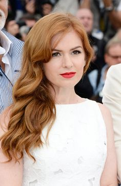 The Redheads: Someone once said that redheads should steer clear of red lipstick, but Isla Fisher proves that scarlet strands and ruby lipstick make a fine pair.