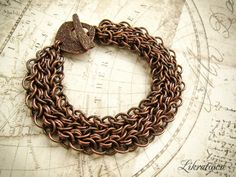 Aragon chainmaille bracelet.  Tierra cast, copper wire.  Handcrafted.