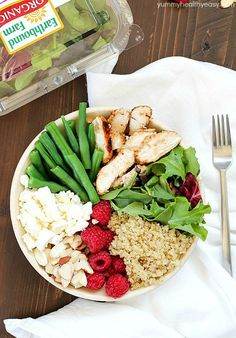 Check out this yummy salad bowl recipe full of grilled chicken, cooked quinoa, kale, raspberries, sliced almonds, feta cheese, green beans and a homemade basil vinaigrette. Super healthy and absolutely delicious!