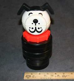 70's fisher price plastic dog stacking toy - the ear was chewed on mine.