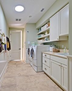 Chores to Adore A combination mudroom/laundry off the garage includes pretty beadboard cabinets by Merillat, a Shaker peg rail for coats and...