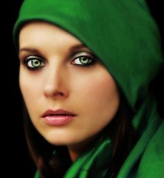 green eyes         Wow This is a beautiful picture. Her face features are beautiful. Love the green eyes and clothing.