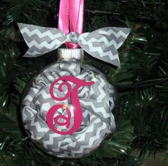 Chevron Christmas Ornaments by daintydesignsshop on Etsy, $11.99  Clear ornament with ribbon coiled inside, and initial on the front