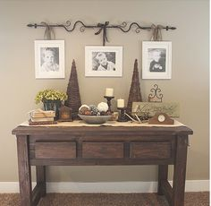 Obviously with more modern decor, I love the rod with hanging photos! Rustic Table, Diy Table, Sofa Table Decor, Decorating An Entry Table, Decorating A Mantle, Sofa Tables, Wood Table, Rustic Wood, Furniture Chairs