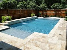 Terrific Non Slip Pool Deck Materials with Travertine Around Swimming Pools and Wood Shadow Box Fence Panels also Sheer Descent Waterfall Design from Pool Tiles, Pool Decks, Pool Coping Shadow Box Fence, Swimming Pools Backyard, Small Backyard Pools, Small Swimming Pools, Swimming Pool Tiles, Backyard Pool Landscaping, Luxury Swimming Pools, Pool Spa, Backyard Ponds