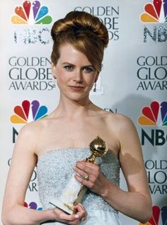 """Nicole Kidman in the Press Room With Her Award for Best Actress in a Comedy/Musical for """"To Die For"""" (1995); at the 53rd Golden Globes on January 21st, 1996"""
