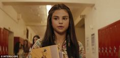 Hitting the books: Selena Gomez plays a high school student with a crush on her gym teacher in her new music video for Bad Liar