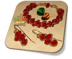 PULSERA Y ZARCILLOS TECNICA ENTRELAZADO  Elaborado por la Artesana Diseñadora Milady Arévalo en Cobre y Cristales Bañado en Oro.