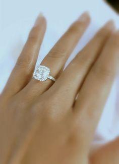 1 Carat 14K White Gold Classic Halo Style Cushion Shape Diamond Engagement Ring with a 0.75 Carat H-I I1 Center