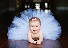 baby photo tutu....do not put tulle all the way around the crocheted head band or whatever you are using...leave opening to lay her on her stomache/complete and save for later photo ops when she can sit and stand
