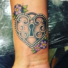 Wrist Heart locket tattoo with flowers