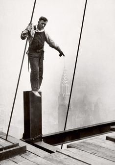 Lewis Hine - Empire State building construction worker touches the top of the Chrysler building 1930 Member Ironworkers Local
