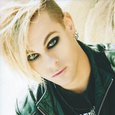 Tommy Joe Ratliff! He's Bass Guitar player in Adam Lambert's band. He's a straight pretty boy!