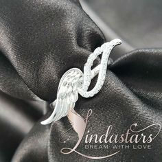 Fly on the angel's wing! Adorn your fingers with this exquisite pair of angel wings, one wing scattered with glossy zircons, the other decorated with delicate feathers.  Made from the highest quality .925 sterling silver with a high polished finish, this angel wings #ring boasts sty le and gorgeousness from its entire design. Pair it with your cocktail dress to look mesmerizing.   https://www.lindastars.com/collections/together-for-ever-collection/products/angels-wink-ring