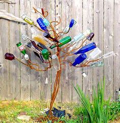 Bottle Tree from Bourbon & Boots  Love the style of this ! In the vid on one of these two I posted she makes bottle vines as well ! Hippie Hugs with Love, Michele~♥~