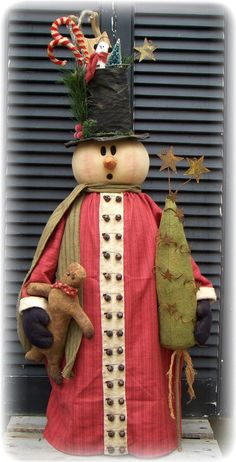 You will get complete directions along with color photos. This primitive Snowman is 36 tall You will get two tree patterns to use in this design. Thank you to my dear friend Tonya of back porch pickins for her help in creationg this wonderful guy. Primitive Country Christmas, Primitive Crafts, Primitive Christmas, Christmas Snowman, Winter Christmas, All Things Christmas, Christmas Ornaments, Christmas 2017, Snowman Door