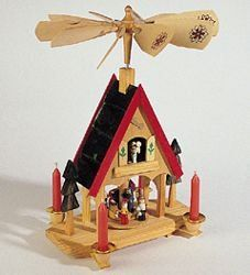 The Kurt Adler Wooden Alpine House Carousel is certain to become a beloved part of your home's holiday decor. This decoration comes with four candles that can be used to rotate the house's windmill, which then turns the adorable carousel below it. German Christmas Decorations, Christmas Nativity, Christmas Candles, Christmas Home, Christmas Ornaments, Christmas Ideas, Christmas Shopping, Christmas Crafts, Xmas