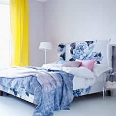 Bedroom with bold curtains and floral bed