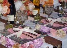 Elegant and romantic table setting. Beautiful roses in lovely shades of pink adorn this creative and unique table. Love this idea for weddings and romantic events.