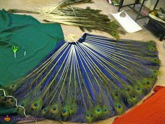 Full skirt after attaching first layer of peacock feathers. Peacock - Homemade costumes for women Peacock Halloween Costume, Halloween Costume Contest, Halloween Kostüm, Peacock Dress, Peacock Theme, Peacock Makeup, Costume Works, Animal Costumes, Homemade Costumes