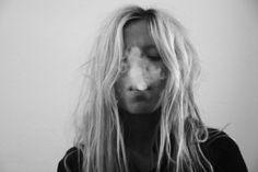 black and white blonde smoker