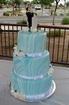 Marbled Blue Wedding Cake My brother is getting married and that is the same wedding cake topper they have and same colors i love this