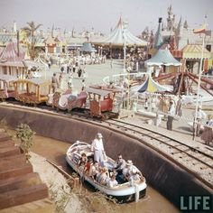 Disneyland opening day 1955 - Storybook Land Canal Boats and Casey Jr. Railroad in Fantasyland. From Life Magazine, photos by Allan Grant and Loomis Dean. Color corrected by United Style