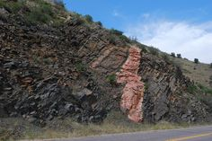 A classic intrusion of molten pink granite into layers of sedimentary rocks causing them to partially melt forming gneiss and schist. - Golden Gate Canyon - near Golden Colorado.