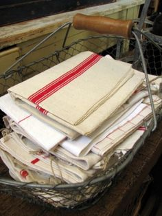 french linen tea towels and the french wire basket ~available at American Home & Garden in Ventura CA