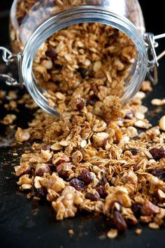 Gingerbread Granola: molasses, canola oil, salt, cinnamon, ginger, cloves, rolled oats, coconut, walnuts (pecans or hazelnuts, chopped), raisins