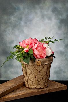 4.99 SALE PRICE! With its straightforward design and rustic appeal, this Chicken Wire Planter makes the perfect accent for your farmhouse inspired home or ev...