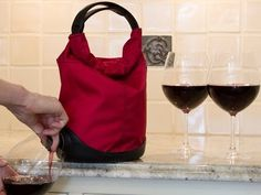 A smarter way to transport boxed wine. Menu's Baggy Wine Coat looks like a handbag, dispenses wine like a pro. http://www.dailygrommet.com/products/menu-baggy-wine-coat/