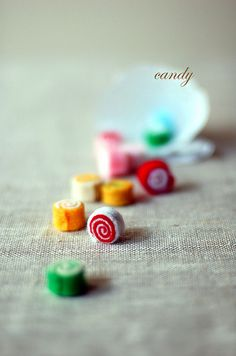 felt candy - maybe roll up some felt sheets and needle felt them together? must try sometime