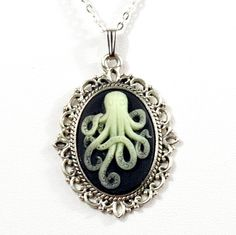 Steampunk Antiqued Silver Victorian-Style Necklace with Glow-in-the-Dark Octopus Cameo Tentacles by Velvet Mechanism. $45.00, via Etsy.