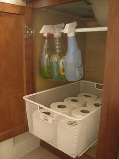 bathroom under sink! I freed up so much space. I used a tension rod.  This doesn't lead to a link (just a picture) but the picture shows you what you need to do.