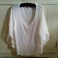 Cream  t-shirt with sheer batwing sleeves Cream T-Shirt with batwing sleeves *  sheer sleeves * comfy, roomy and cute * V-neck is quite low and will show cleavage * sz Large no prob fitting XL * EUC Tops Tees - Short Sleeve