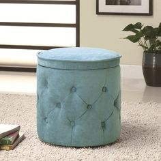 Circular Storage Ottoman 500929 By Coaster features a chenille fabric seat with tufting and a lift- top storage space available in four disticnt colors