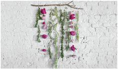 flower hanging garland against white brick wall