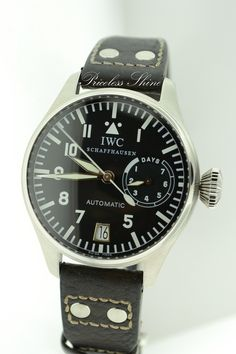IWC Big Pilot 5002 Automatic. Yes, that's a much better crown. Big, but not offensively so. Of course, one would expect IWC to know what they're doing with respect to superior watch design. $9,400.