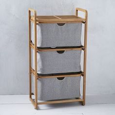 Bamboo Laundry - Triple Shelving Hamper #westelm  An attractive hamper that would fit in our closet or, the hallway.