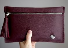 How to make a leather clutch with tassel and embellishment. A DIY step by step tutorial designed by Xenia Kuhn for lifestyle and fashion blo...